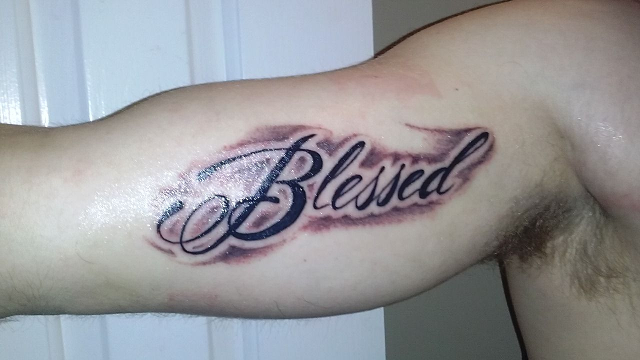 Blessed tattoo on the inner bicep