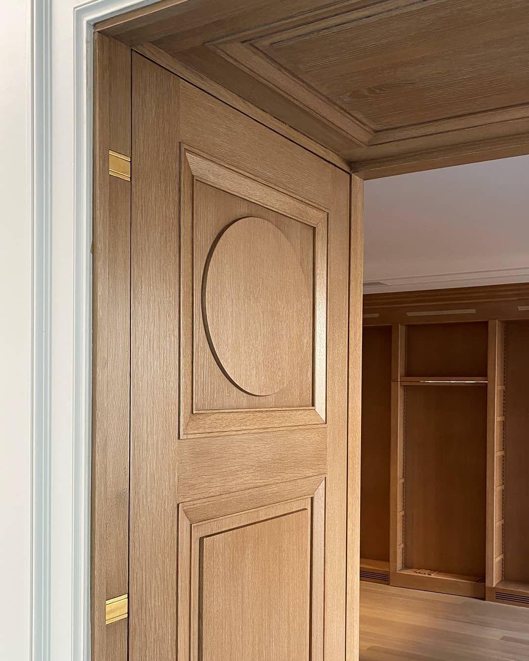 bmc interior doors on custom white oak door with circle panel detail and brass hardware bmc design ultra team custom entry doors oak doors custom built ins custom entry doors oak doors custom