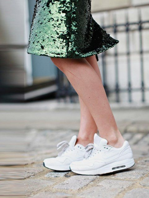 Harriet Stewart wears Nike shoes £99, Topshop skirt.