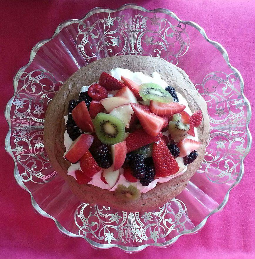 Chocolate Pavlova: a meringue filled with summer fruit: strawberries, blueberries, kiwi, blackberries
