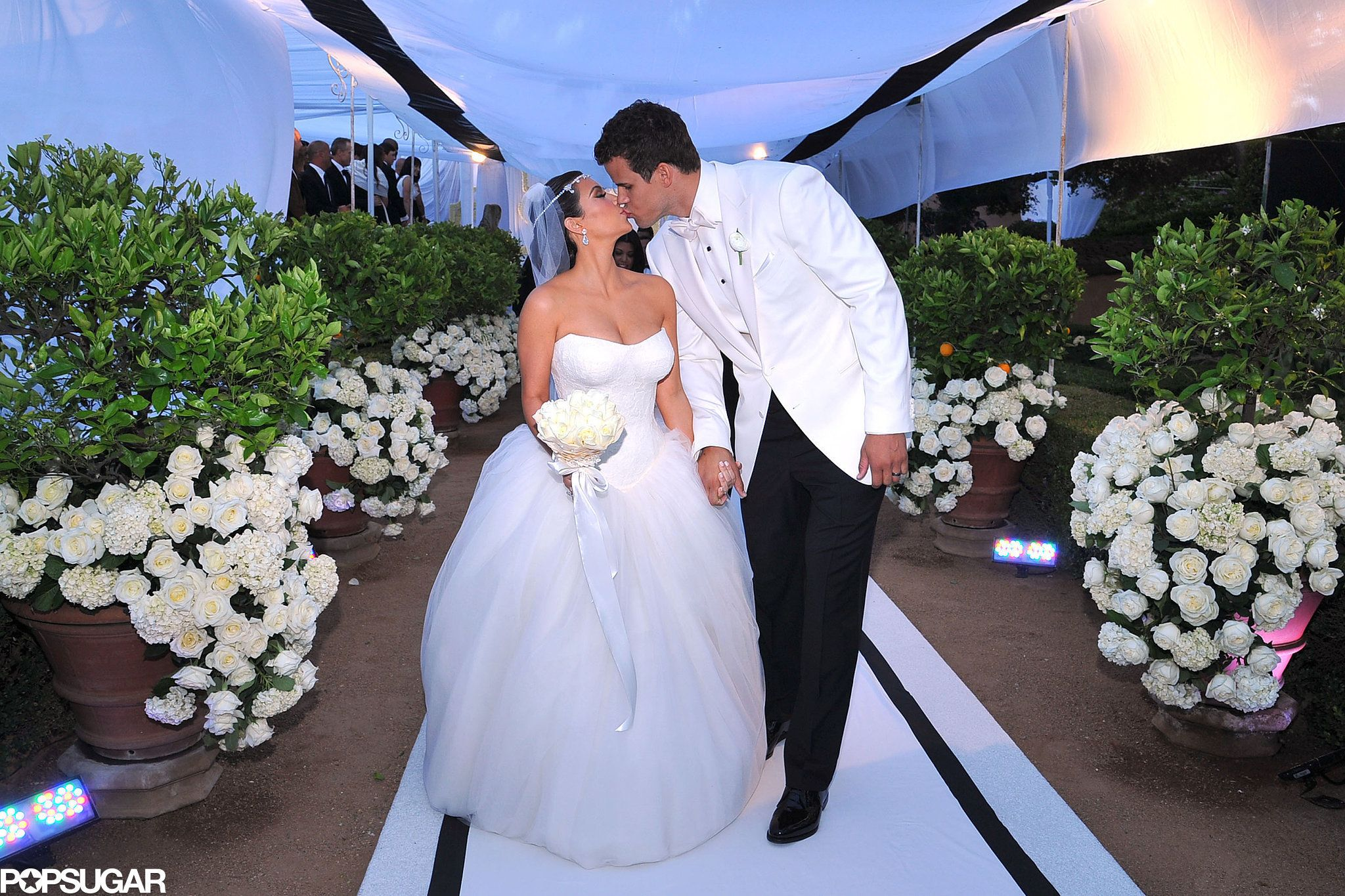 Kardashian and Kris Humphries     Kim and Kris started their 72-day marriage with a Montecito, CA, ceremony that took place in August 2011.