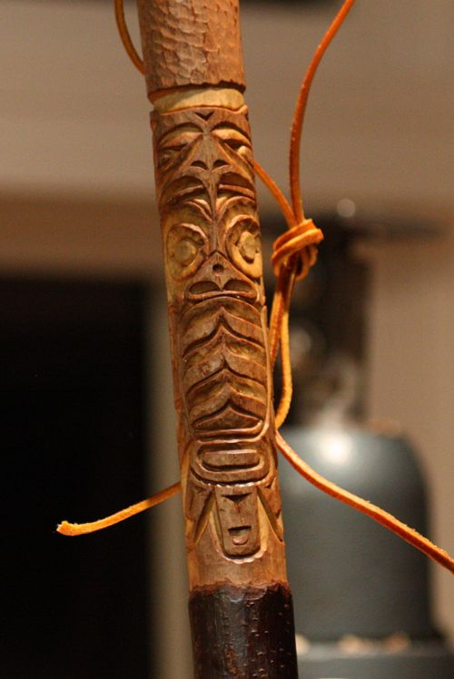 Tiki carving on a walking stick inspirations in wood