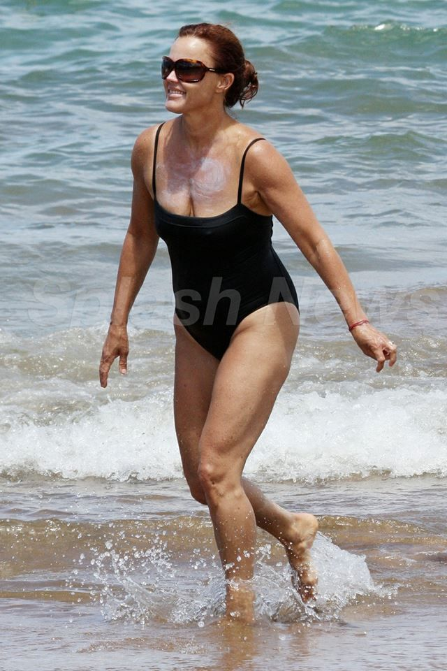 With her slim body and Dark brown hairtype without bra (cup size 36A) on the beach in bikini