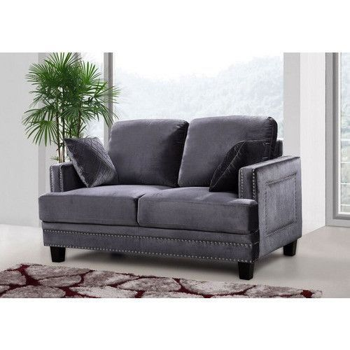 Ferrara Grey Velvet Loveseat. The Ferrara Living room set is an impeccable example of truly memorable, opulent contemporary design. Your Living room will be the height of dignified fashions with top quality materials & construction. The set features a nail head design and is available