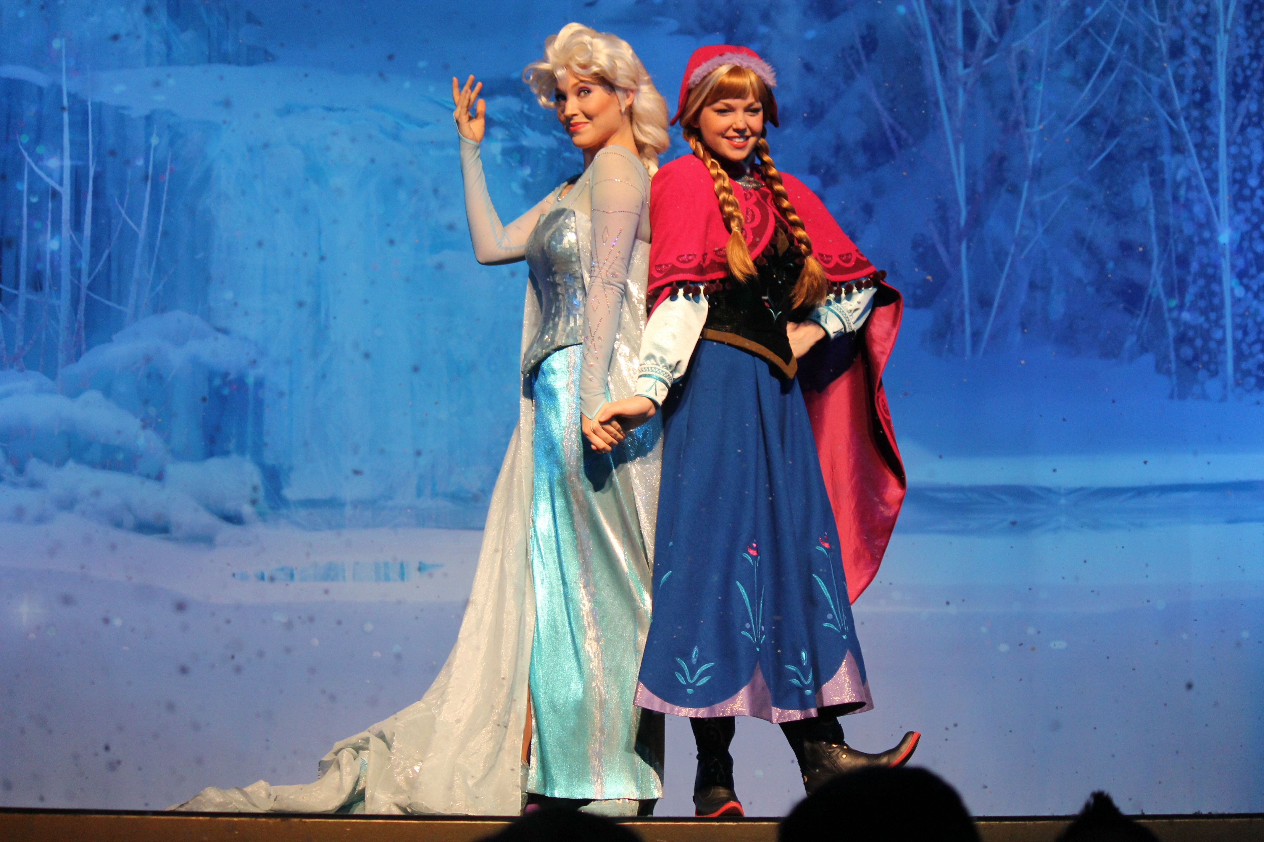 Elsa and Anna on stage at the El Capitan Theatre in Hollywood, CA. Photo by Loren R. Javier. Please do not distribute without attribution.