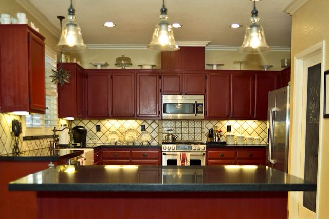 Cottage Kitchen Red Cabinets Spanish Tile Backsplash Honed Black Granite Countertops