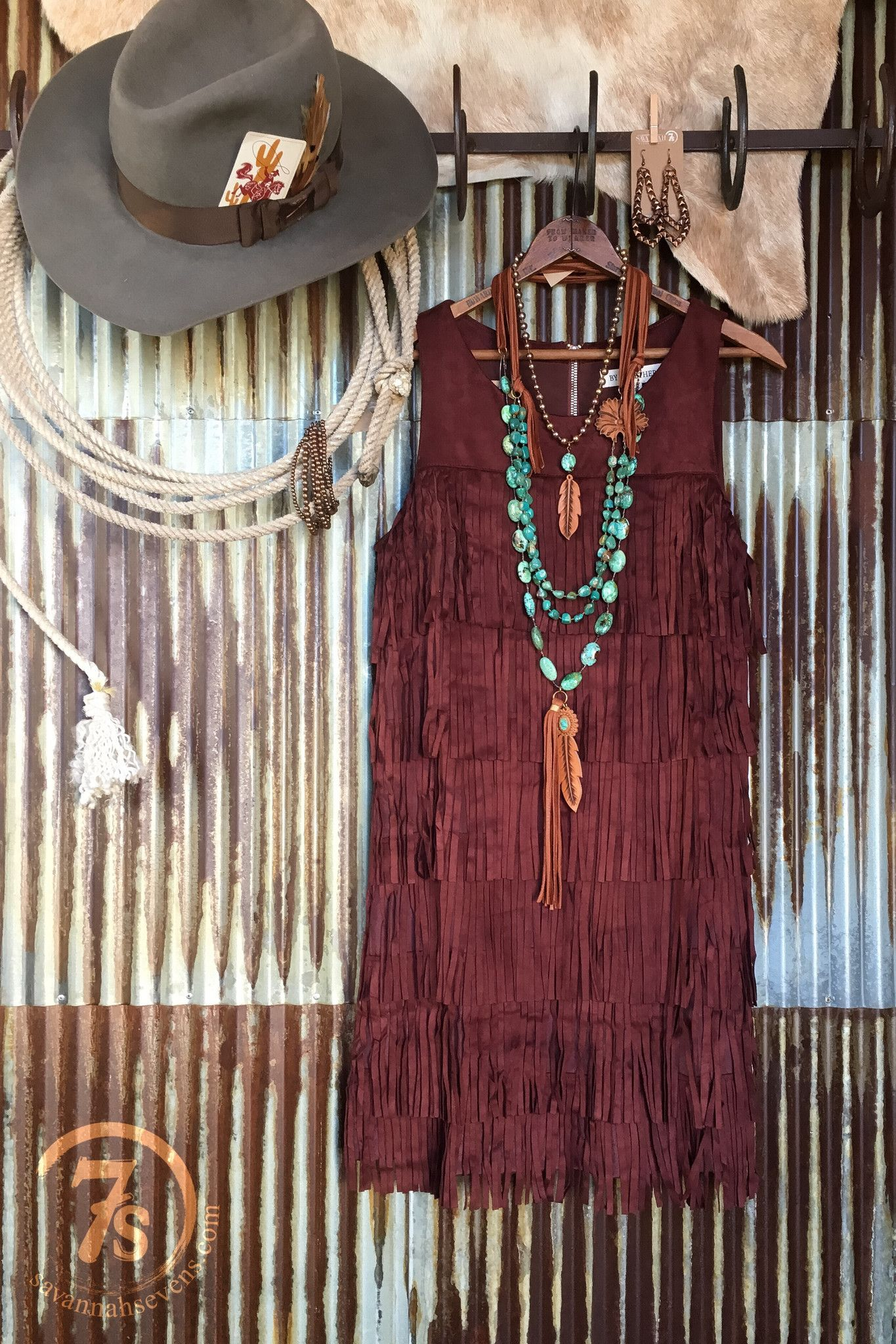 - Wine faux suede fringe dress - Gorgeous deep wine almost chestnut color - Layed fringe front - Sleeveless - Zipper back - Fully lined - Nice flattering fit without being snug anywhere - Runs true to