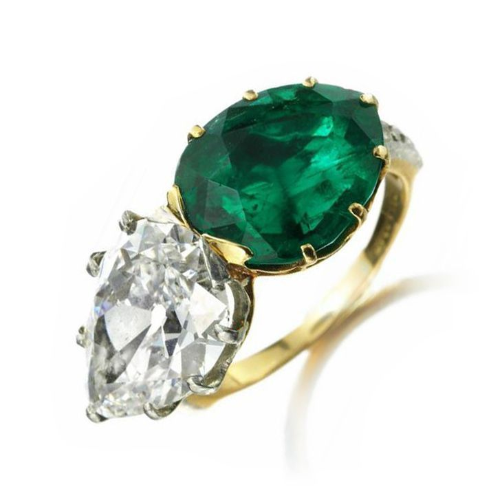 An Colombian Pear shaped Emerald and Pear shaped Diamond Twin