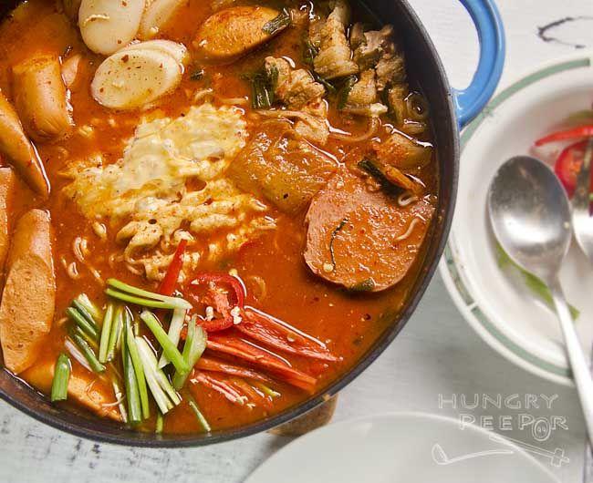 A Bright Red Pot Of Korean Budae Jjigae (부대 찌개)
