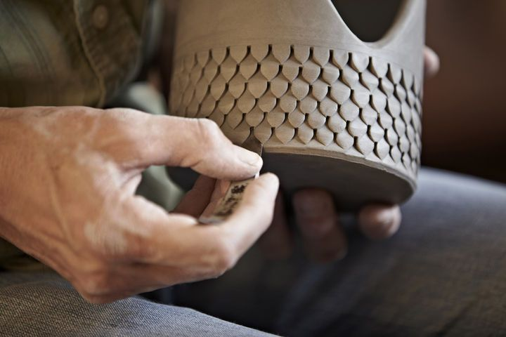 Wisner impressed and incised his pattern into the clay, using a tool he fashioned from a hacksaw blade.
