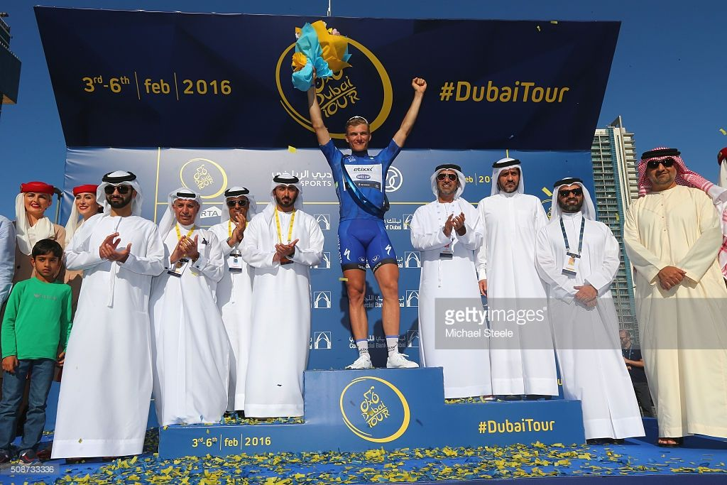 Marcel Kittel of Germany and Etixx Quick Step celebrates the stage win and overall GC winner alongside dignataries during the podium presentations following the Business Bay Stage Four of the Tour of Dubai on February 6, 2016 in Dubai, United Arab Emirates.