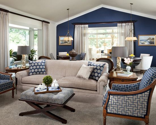 navy accent wall, white trim, light curtains with dark rods, light