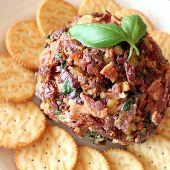 Greek cheeseball with feta, sundried tomatoes, kalamata olives, basil, walnuts and bacon. A perfect appetizer for entertaining!
