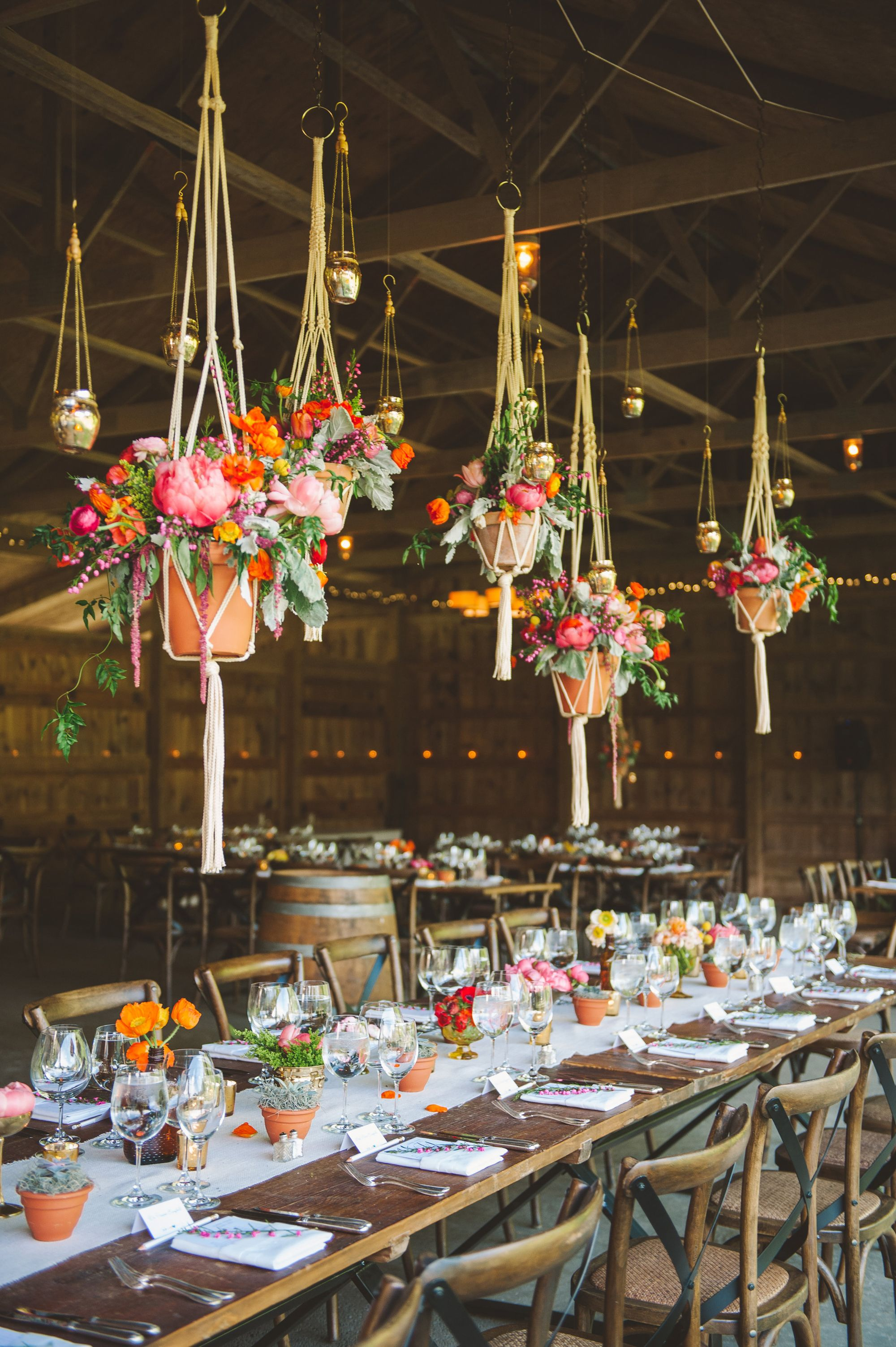 Suspended floral arrangements in a barn wedding reception centerpieces arubaitofo Image collections