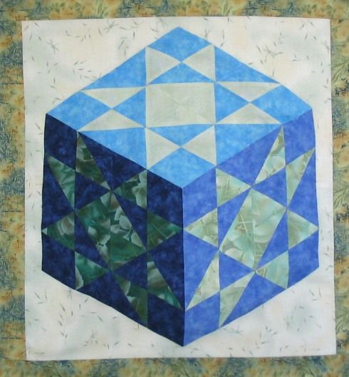 "Stolen quilt alert.  Karen Combs' beautiful Patchwork Illusions quilt top: ""Light Crystal Star"".  See her post for details."