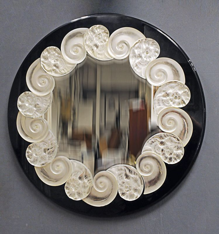 """Lalique """"Oceania""""  the molded clear and frosted glass shells around a circular plate and bordered…"""