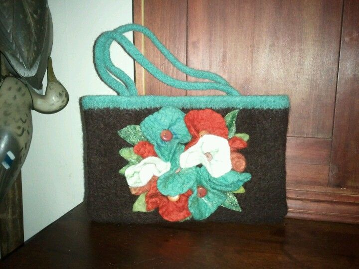 Hand knit , felted purse with handmade 'felt flowers and leaves, vintage buttons, cotton lining... More beautiful in reality than pic!