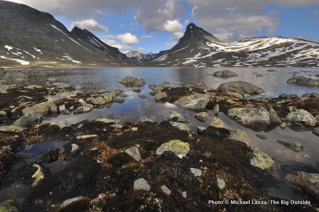 Walking Among Giants: A Three-Generation Hut Trek in Norway's Jotunheimen National ParkKyrkja (peak), above Leirvatnet (lake), at Leirvassbu Hut.