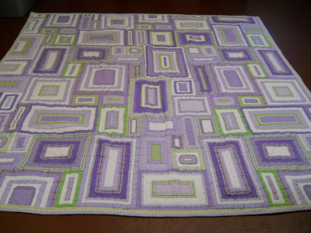 This quilt will be hung on the wall in our master bedroom.