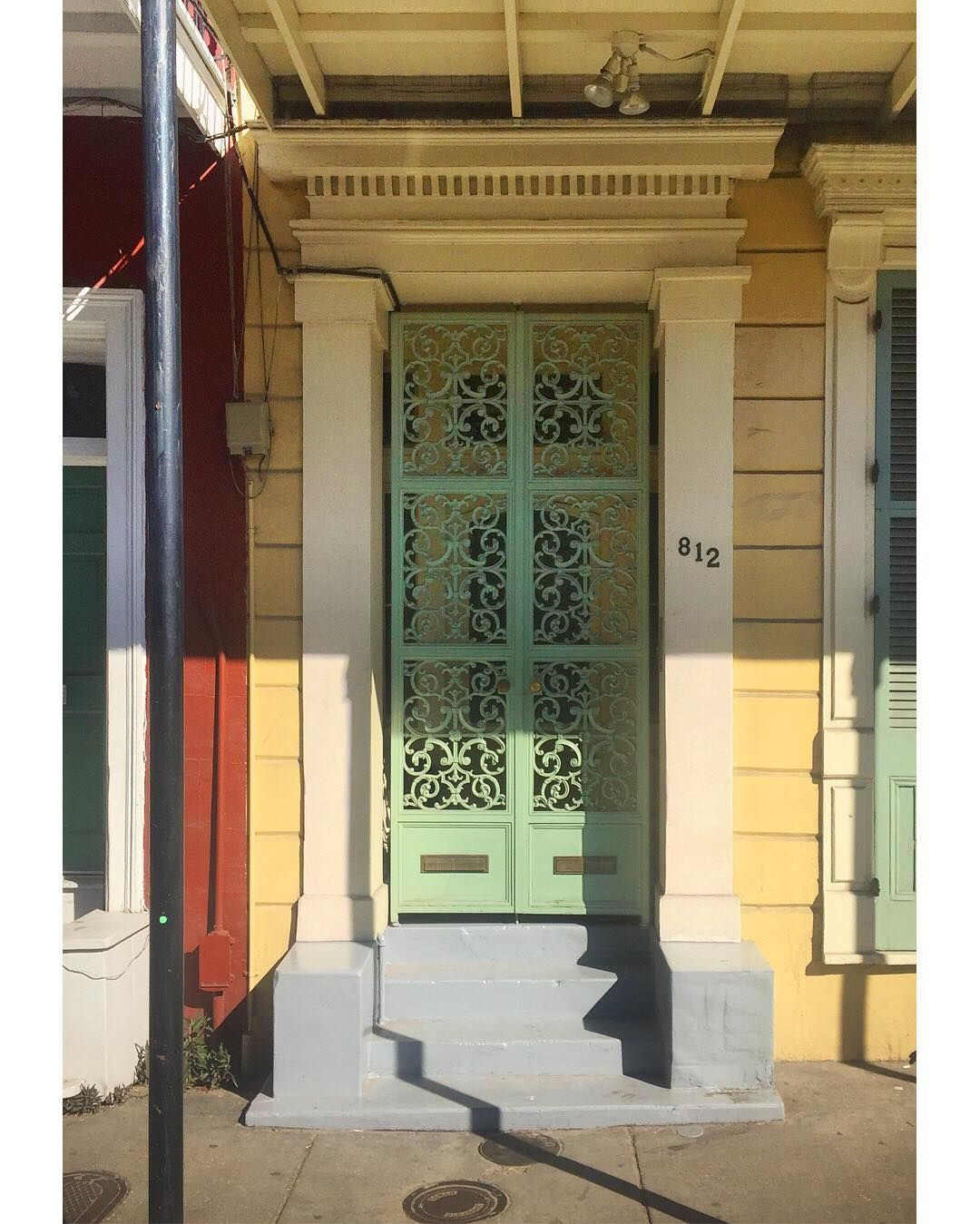Historic New Orleans Greek Revival door with Doric pilaster surround and cast iron gate in & Historic New Orleans: Greek Revival door with Doric pilaster ...
