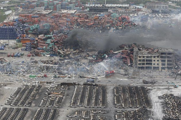 Rescuers work at the site of the warehouse explosions in Tianjin, China, on Aug. 15, 2015.