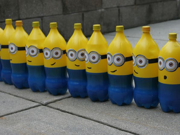 Despicable Me Minion Birthday Party | The Ruby Lake (i think it would be funner to shoot these bottles down with little nerf guns for boys)