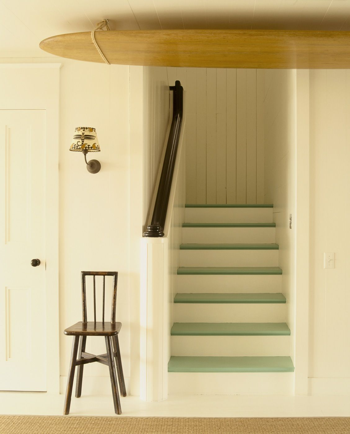Light Green Stair Treads On White Risers.