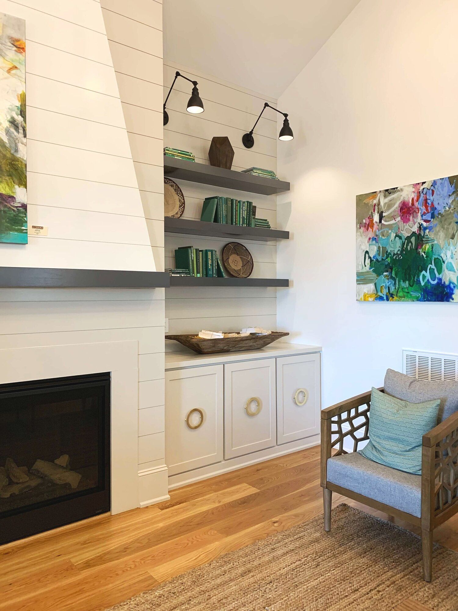 Model Home Ideas - the last batch of ideas for 2019! Those light fixtures are just fun - and they're adjustable! This makes them more useful over the years and you change out what you're displaying on your shelves. The cabinet hardware is big, bold and beautiful!