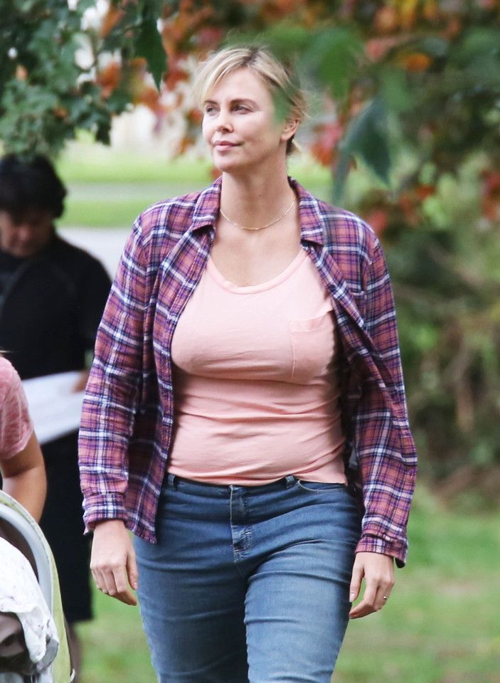 Charlize theron reveals fuller figure after gaining 35lbs for new dressed in a dowdy pair of jeans t shirt and checked shirt the weight transformationbreadcharlize theronweight voltagebd Gallery