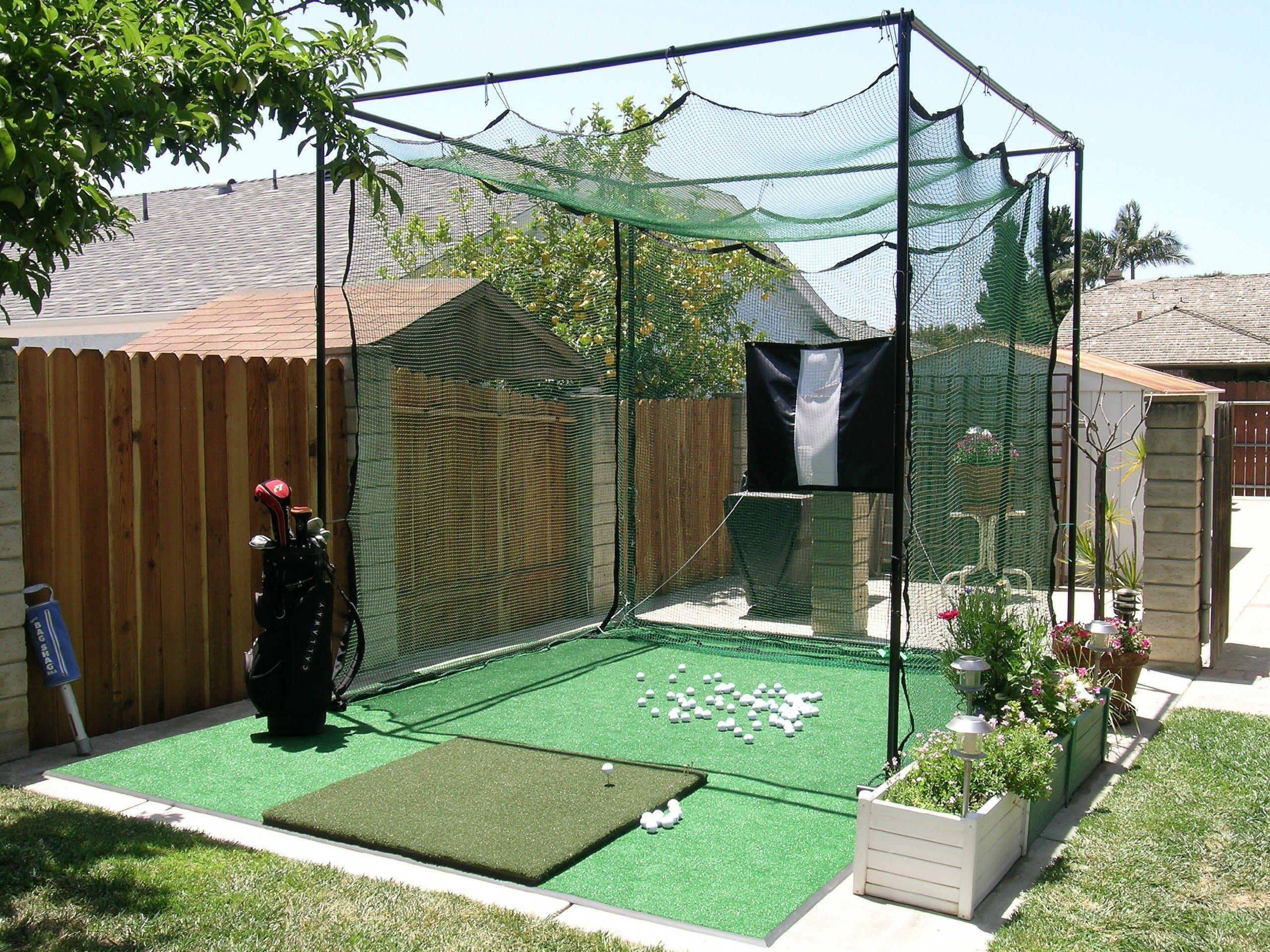 My hitting cage #golfnet   Backyard, Backyard putting green, Green backyard