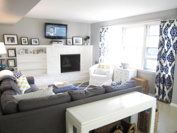 family room with off-centre fireplace. colors too, navy, gray pop