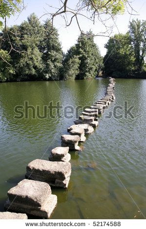 stock photo : A row of stones in water