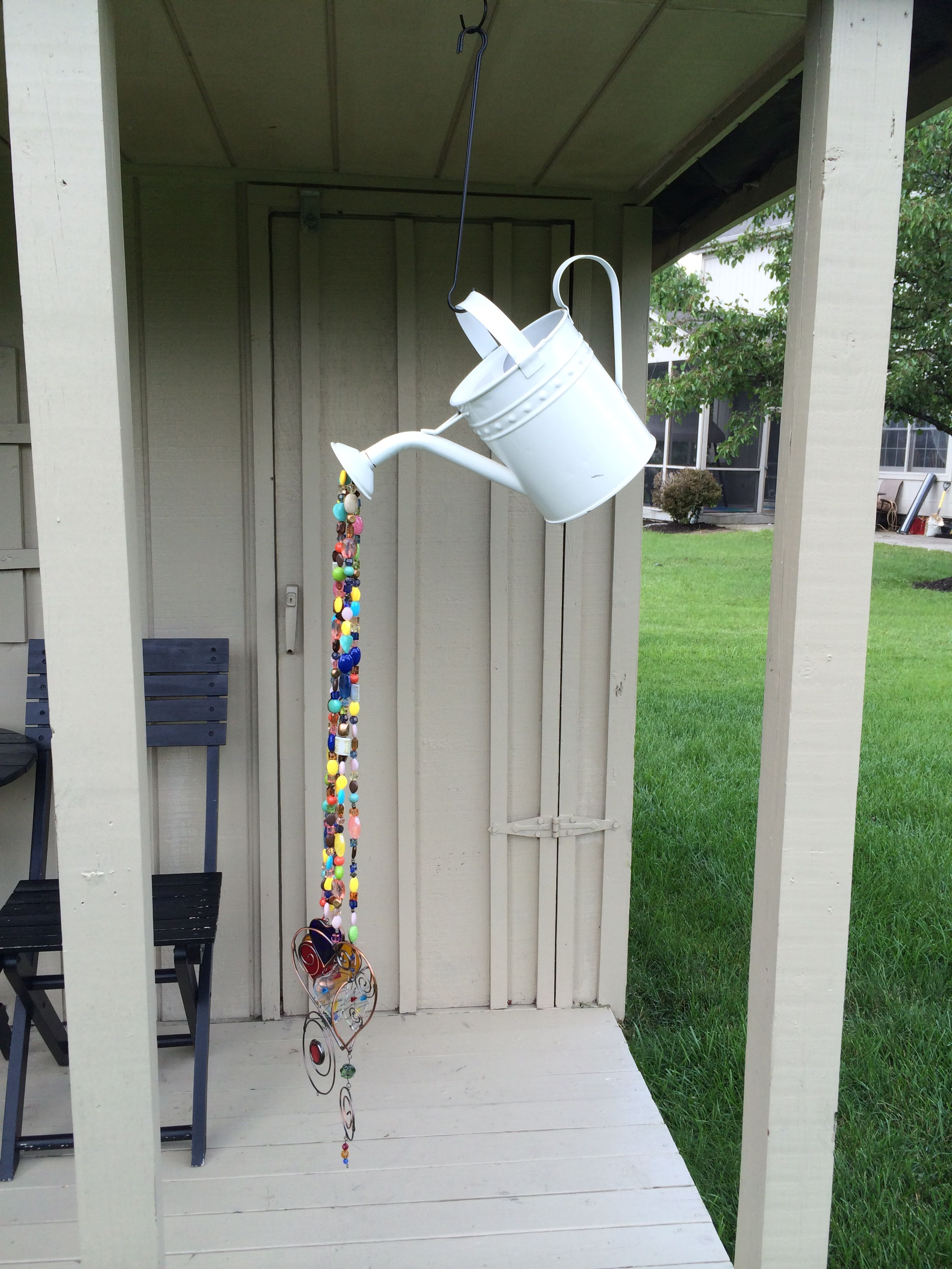 Homemade wind chime from watering can and beads