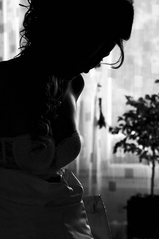 wedding bridge sillouette dressing up dress hair curl black and white monochrome morning preparation