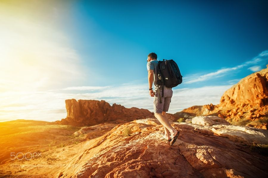 Popular on 500px : bearded hiker at valley of fire park in nevada looking at sunset by JoshuaResnick