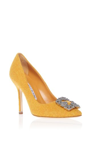 fa8310dd749a56 This **Manolo Blahnik** pump is rendered in tweed and features an encrusted  buckle and minimalist silhouette.