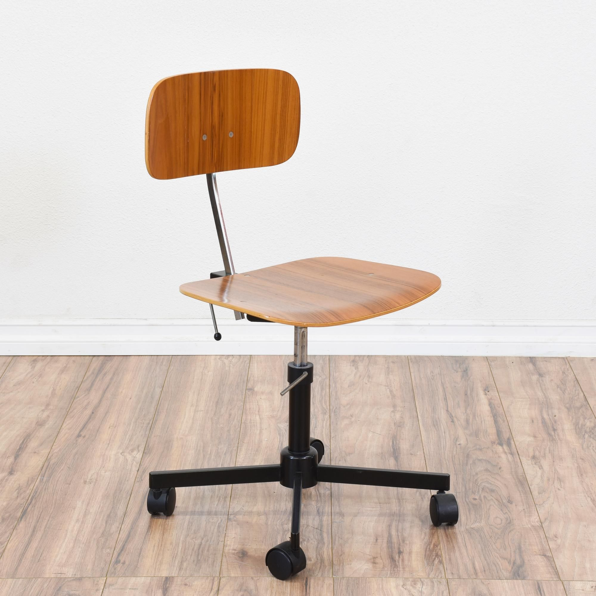 "This ""J¸rgen Rasmussen"" Kevi office chair is featured in a bent"
