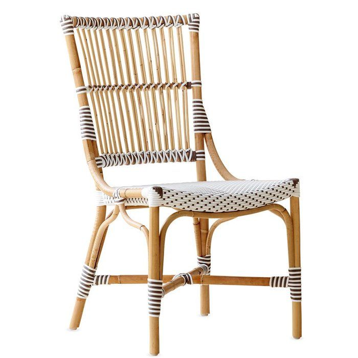 Characteristically seen in upper end cafés across Europe, this contemporary take on the classic bistro Veranda Side Chair is handmade using the highest quality Malacca cane rattan, stainless steel hardware, and exclusive art fiber synthetic. Perfect for indoor or outdoor use.
