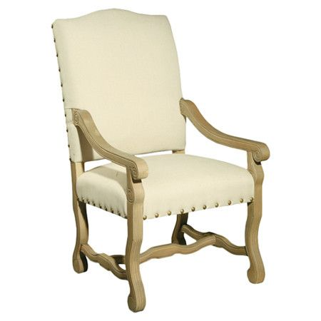 Oak-framed arm chair with nailhead-trimmed linen upholstery and carved details.  Product: ChairConstruction Material...