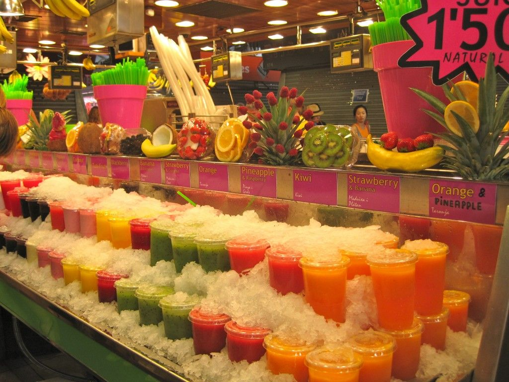 Juices at the market in Barcelona Fruit company, Fruit
