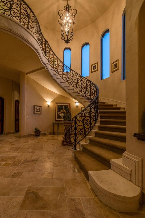 Mediterranean staircase with high ceiling sandstone floors mediterranean staircase with high ceiling sandstone floors curved staircase chandelier arched window aloadofball Choice Image