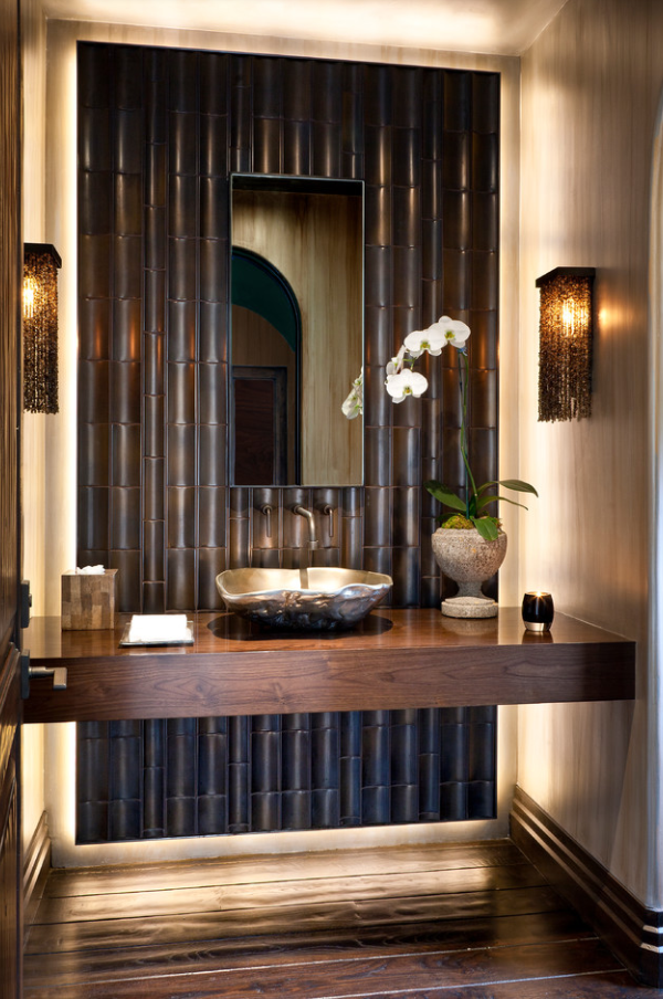 organically shaped bronze vessel #sink, the floating walnut slab counter top and bamboo tiles strikes a balance between traditional and modern... | #powderroom #bathroom
