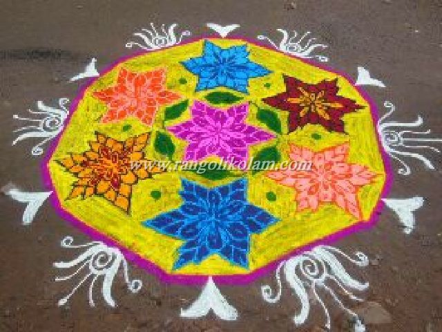 Pulli Kolam With Bright Yellow Colour