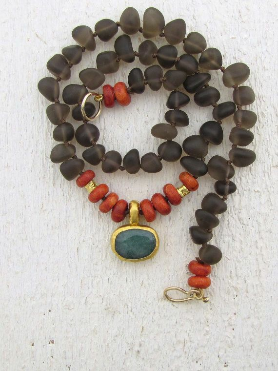 Black and red necklace with black pendant.
