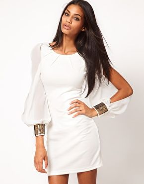Perfect for a night out.Beautiful Bodycon dress with embellished sleeves.