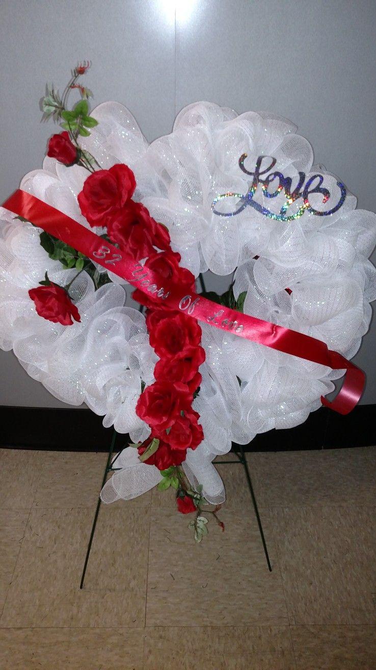 Bleeding heart funeral floral arrangement Funeral floral