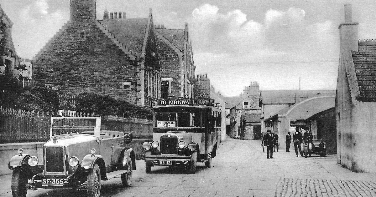 Old photograph of a vintage car, bus and people at the Pierhead in ...
