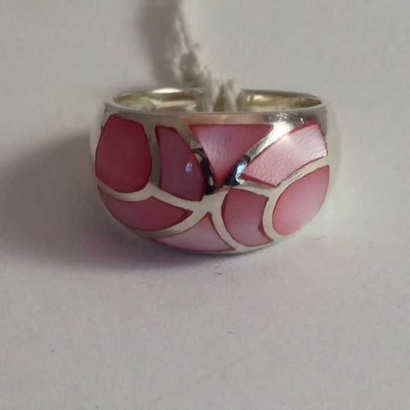 % 925 Sterling Silver, pink MOP Size 7 ring  Lusterous, pink  % Mother of Pearl,  inlaid into a size 7,  % 925 Sterling Silver band, that has decorative lines of silver throughout face of ring. Hand made, high quality, very pretty, and comfortable wear. NWOT  Hand made Jewelry Rings