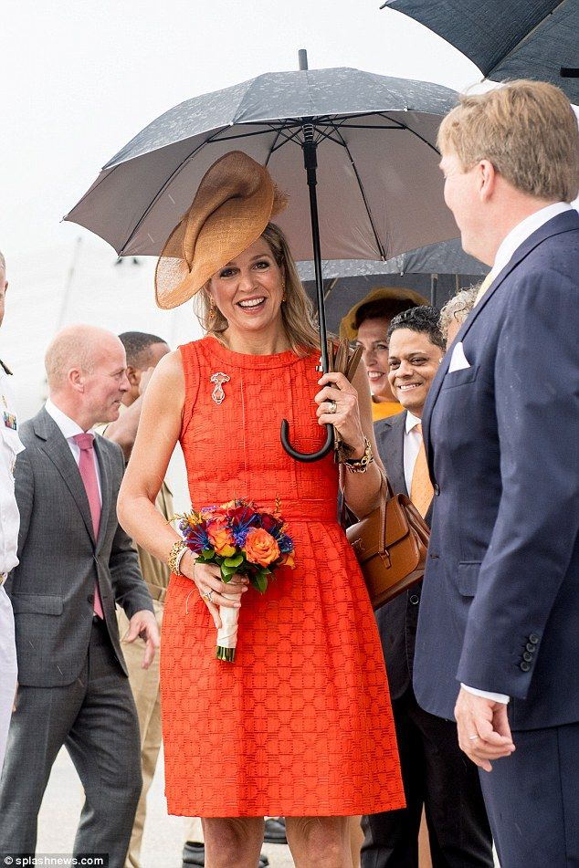 be68a80fcffe32 Maxima looked in high spirits as she and husband Willem-Alexander arrived  to damp weather