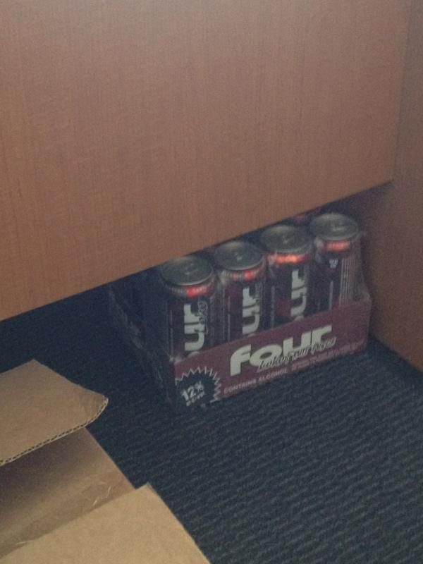Which staff member keeps a case of Four Loko under their desk?